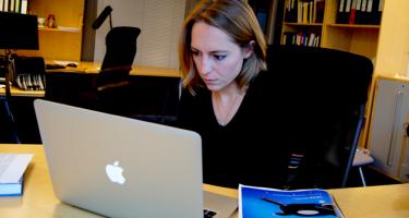 Natalie Larson at computer