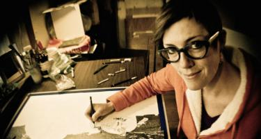 Nina Elder works at her drawing desk