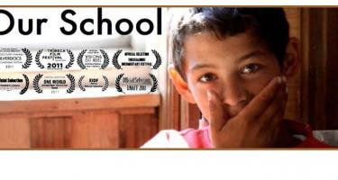 Our School poster with award logos and young child covering mouth with hand