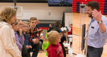 A demonstration of gravity at the physics booth draws the attention of several children.