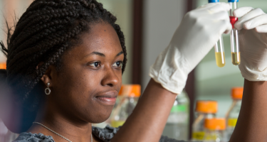 Queenster Nartey '16 with test tubes