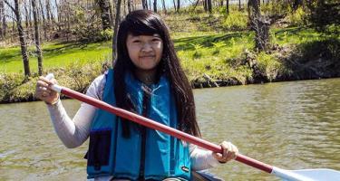 Rebecca Wong paddling on the lake