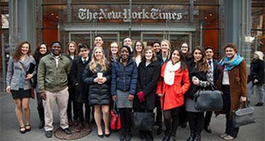 A group of students poses in front of The New York Times office