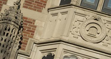 Carved stonework includes the Grinnell College seal