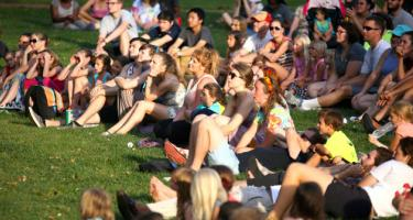 A crowd of all ages gathers to watch a performance during Grinnell's Summerfest 2016