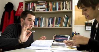 Strax Matejic '17 and Prof. Gemma Sala discuss Strax's mentored advanced project