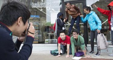 International students make a human pyramid outside Gosselink's Gifts and Interiors