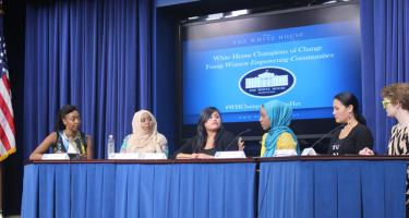 Moderator and 5 of the Champions of Change sitting at a panel discussion.