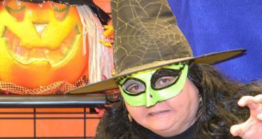 Witch costume and Jack-o-Lantern