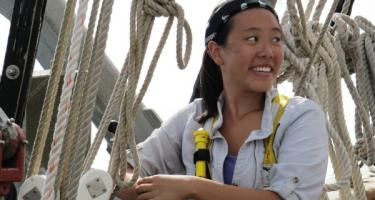 Jennifer Dong '15 on deck in front of rigging.