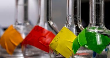 Flasks used in chemistry experiments have brightly colored labels