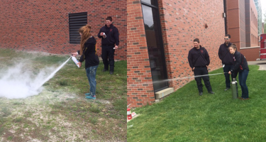 Students discharge fire extinguishers during a safety program.