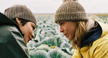 Still from Femde Haut of the main characters talking in a field