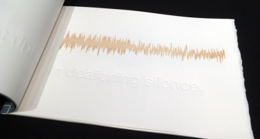 Page in a book showing an audio waveform labeled 'in deafening silence'