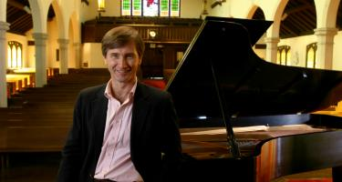 Eugene Gaub at piano in Herrick Chapel