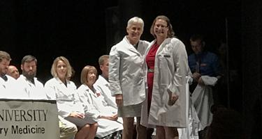 Miranda Thomas '17 and Sara Mathews '82 at Thomas' white coat ceremony