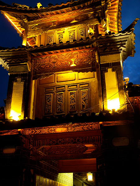 multifloored, pagoda-roofed building lit from outside