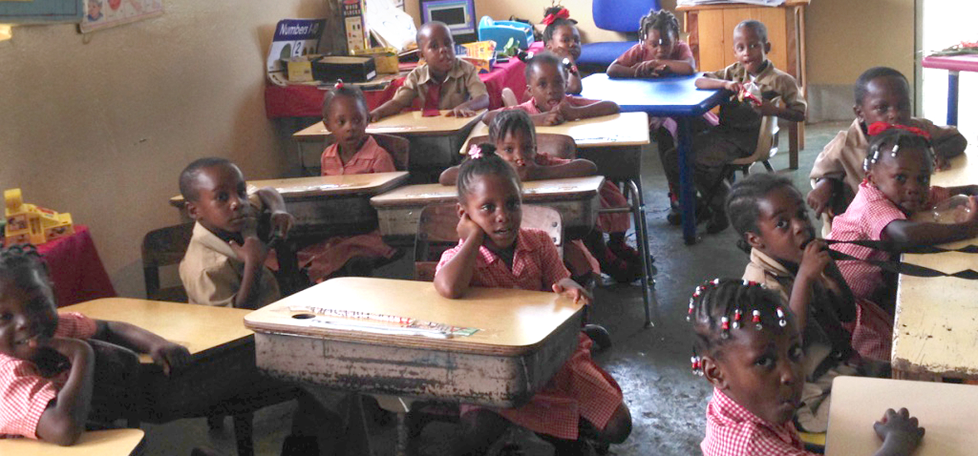 Children in a classroom at Bottom Halse Hall Basic School in Clarendon, Jamaica