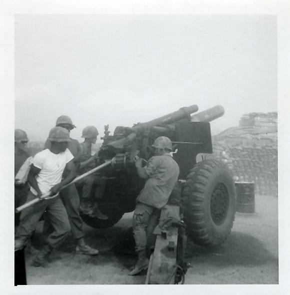 Men manning an artillery gun